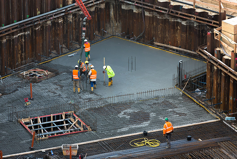 workers finishing concrete onsite